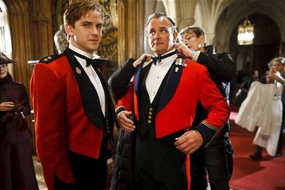 Dan Stevens (Matthew Crawley) stands by while Hugh Bonneville (Robert Crawley) has his wardbrobe adjusted.
