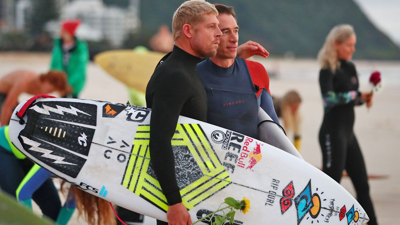 Surfing stars Mick Fanning and Stephanie Gimore attend 'incredible' paddle-out tribute to 'Chumpy'