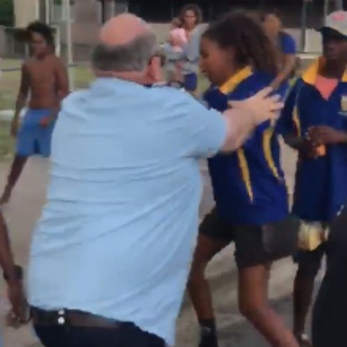The officer grabs for the schoolgirl before she is knocked to the ground. (Facebook)