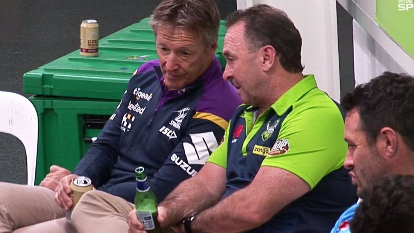 Craig Bellamy and Ricky Stuart share a heartwarming moment following their preliminary final clash. (Nine)