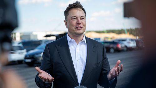 Tesla head Elon Musk talks to the press as he arrives at the construction site of the new Tesla Gigafactory near Berlin.