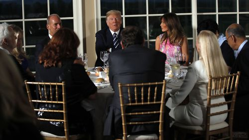 President Donald Trump having dinner at Bedminster Golf Club in New Jersey. (AAP)