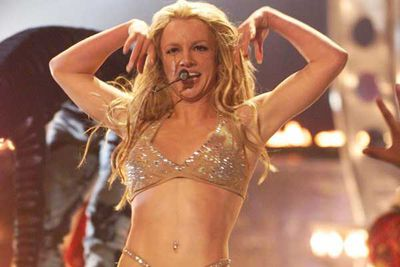 Britney begins to shed clothes and her good-girl image.