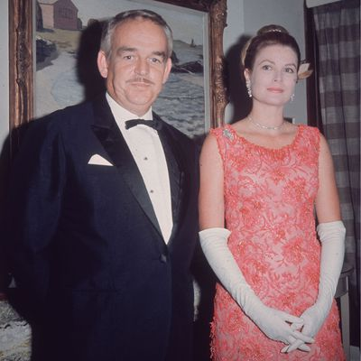 Grace Kelly and Prince Rainier attend a ball, 1965