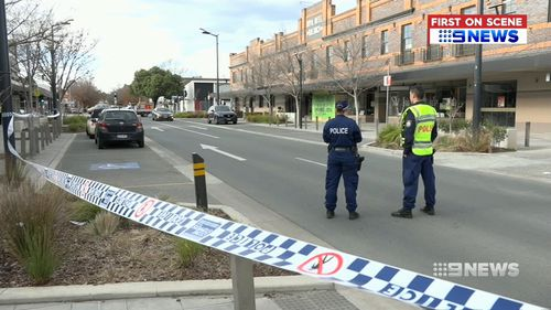 The armed man confronted police at the service station in Queanbeyan before he was shot and taken to Canberra Hospital.