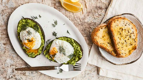 Avocado smash on toast with poached eggs. Healthy breakfast