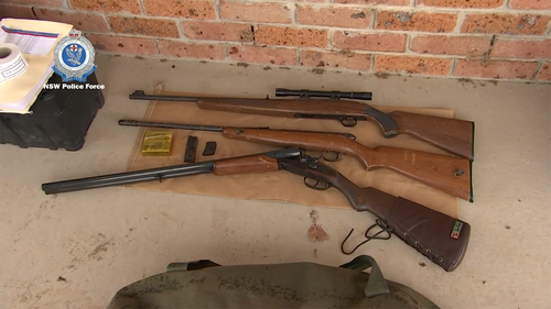 During the surprise property searches police seized several items including 14 firearms, ammunition, prohibited drugs, mobile phones and motorcycle gang paraphernalia.