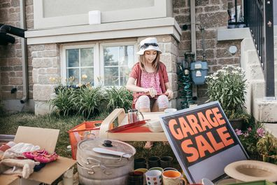 Garage sale in yard with sign