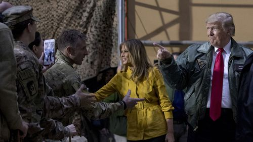 Donald Trump and Melania Trump greeting US troops in Iraq.