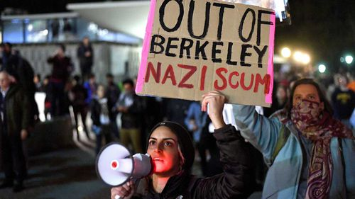 Protesters gather at University of California, Berkeley, over a speech by Milo Yiannopoulos. (AAP)