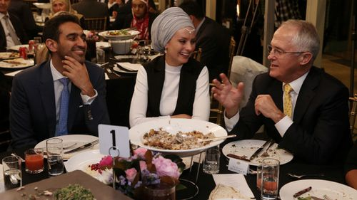 The prime minister with gold logie winner Waleed Aly (left) and his wife Susan Carland. (AAP)