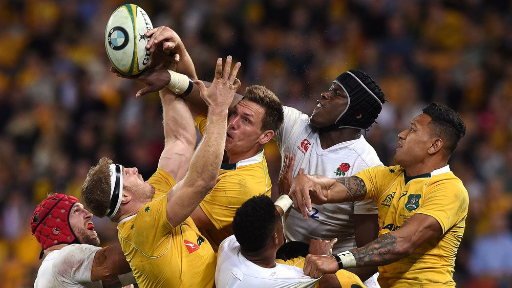 Wallabies and England players contest a line-out,. (AAP)
