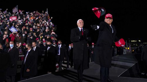 President Donald Trump and Vice President Mike Pence arrive for a campaign rally at Gerald R. Ford International Airport in Grand Rapids, Michigan.