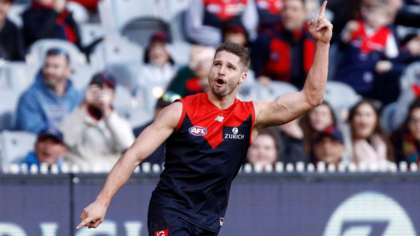 Demons smash Suns, climb into AFL top four