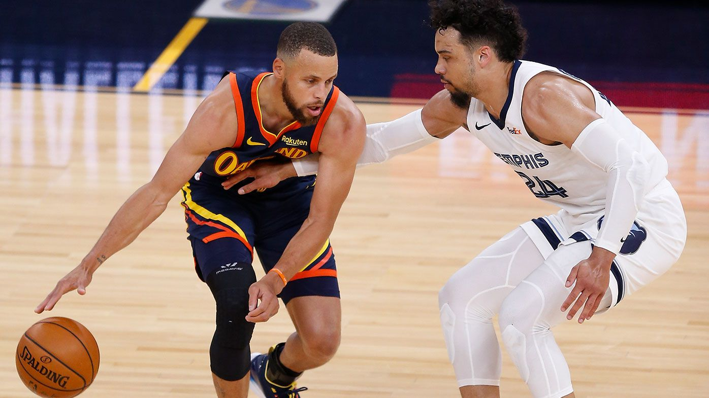 Stephen Curry #30 of the Golden State Warriors is guarded by Dillon Brooks #24 of the Memphis Grizzlies in the first quarter of the NBA Play-In Tournament game at Chase Center on May 21, 2021 in San Francisco, California. NOTE TO USER: User expressly acknowledges and agrees that, by downloading and or using this photograph, User is consenting to the terms and conditions of the Getty Images License Agreement. (Photo by Lachlan Cunningham/Getty Images)