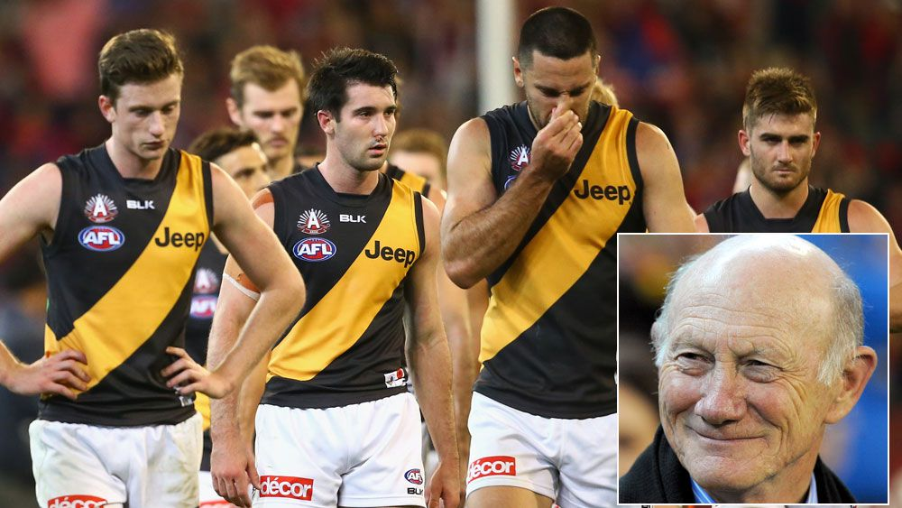 Tigers players walk off the field after their loss to the Demons and (inset) Kevin Bartlett. (Getty and AAP)
