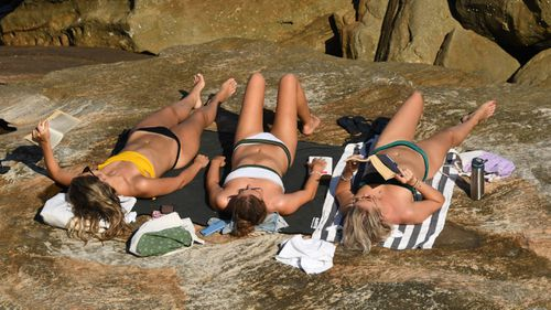 Sunbakers on the rocks at Mackenzies Bay in Sydney