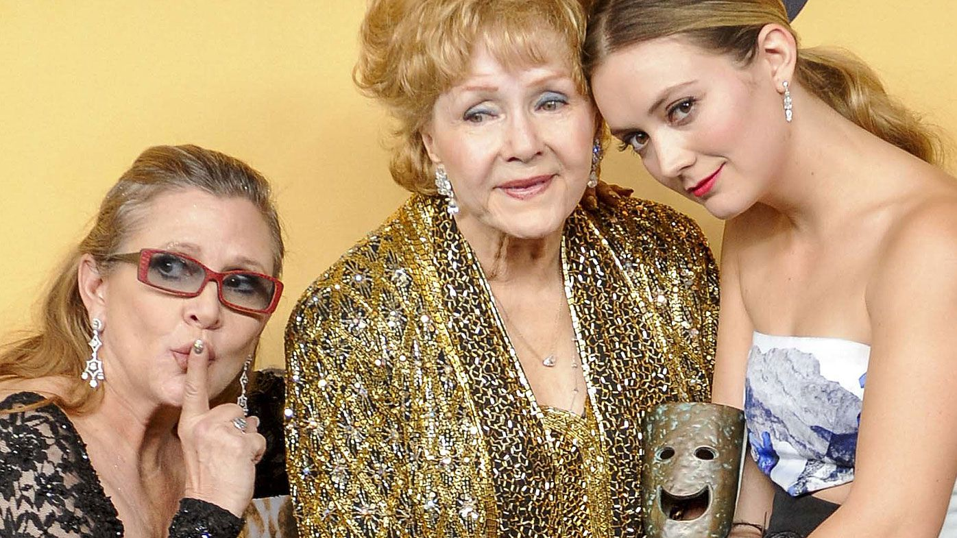 Billie Lourd (left)  is likely to inherit all of her mother's fortune and a large slice of her grandmother, Debbie Renyold's, wealth. (AAP)