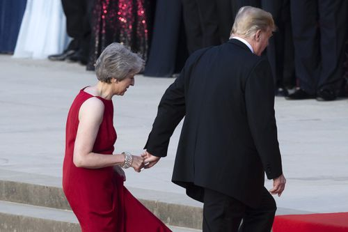 Mr Trump leads Ms May into Blenheim Palace. Picture: AAP