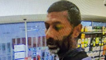 The man is accused of assaulting a woman with a bottle after she asked him to socially distance.
