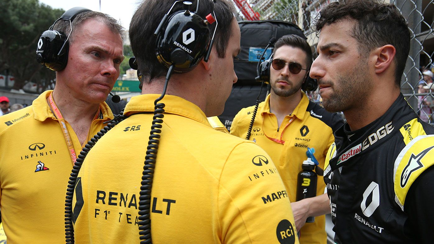 Daniel Ricciardo with Renault team members in Monaco.