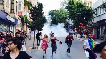 Pride marchers reportedly fleeing from tear gas. (Twitter/@Elif_Safak)