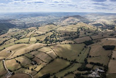 Aerial Photograph of the parched Welsh hill side meadows. This area of Wales is predominantly used for hill side sheep farming, due to the prolonged hot weather much of the grassland has died.