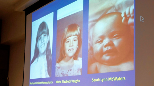 New Hampshire Senior Assistant Attorney General Jeffery Strelzin shows a slide of the three identified victims, Marlyse Honeychurch, left, and her daughters Marie Elizabeth Vaughn and Sarah Lynn McWaters