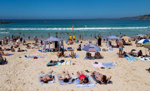 People enjoying the warm weather at Bondi Beach at the weekend.