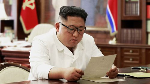 North Korean leader Kim Jong Un reads a letter from U.S. President Donald Trump.