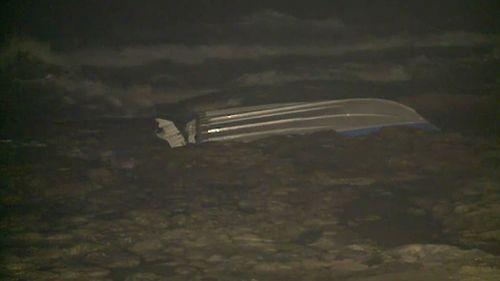 Three rescued after boat capsized near rocks off Sydney's Cronulla Beach