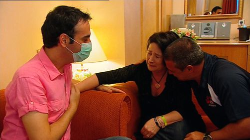 Doujon's parents feel their son's heart beat in Kosta's chest.