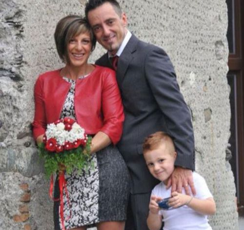 Roberto Robbiano, 43, centre, Ersilia Piccinino, 41, and their nine-year old son Samuele.