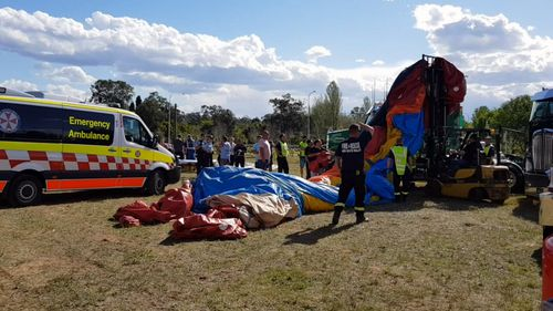 Three children were injured when the jumping castle they were playing on flipped into the air.