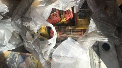 Man charged after nearly $300,000 in cash found in van in NSW