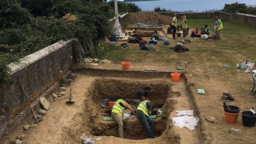 Arcaheologists excavate one of Spike Island's prison graveyards.