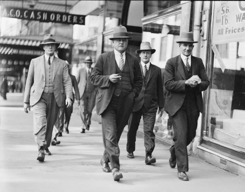Sydney Police Detective Sergeant Thomas McRae (centre) walks down a street with three police officials, Sydney, 20 March 1933. McRae was one of the lead detectives on the cases.