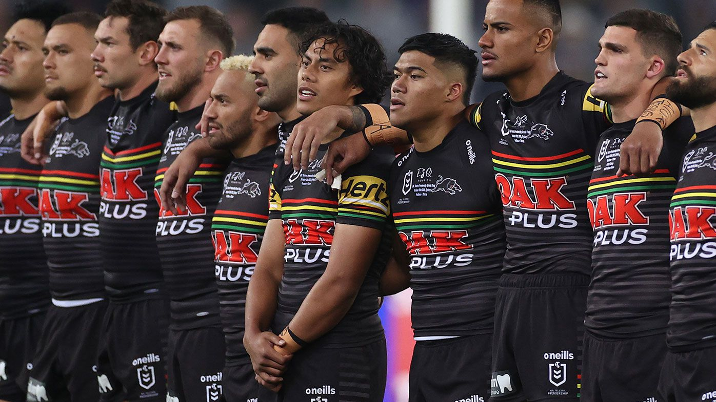 Panthers players stand and sing the national anthem before the 2020 NRL Grand Final