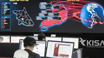 Employees watch an electronic board to monitor possible ransomware cyber-attacks at the Korea Internet and Security Agency in Seoul.