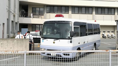 A police vehicle carrying arrested Japanese Yoshitane Yamasaki leaves Sanda Police Station for Prosecutor's Office for further investigation, in Sanda City, western Japan. (AAP)