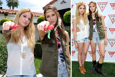 <i>Pretty Little Liars</i> co-stars Ashley Benson and Troian Bellisario keep it cool at Coachella's LACOSTE L!VE 4th Annual Desert Pool Party.