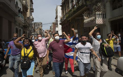 Anti-government protesters march in Havana, Cuba on Sunday, July 11, 2021. (AP Photo/Ismael Francisco)