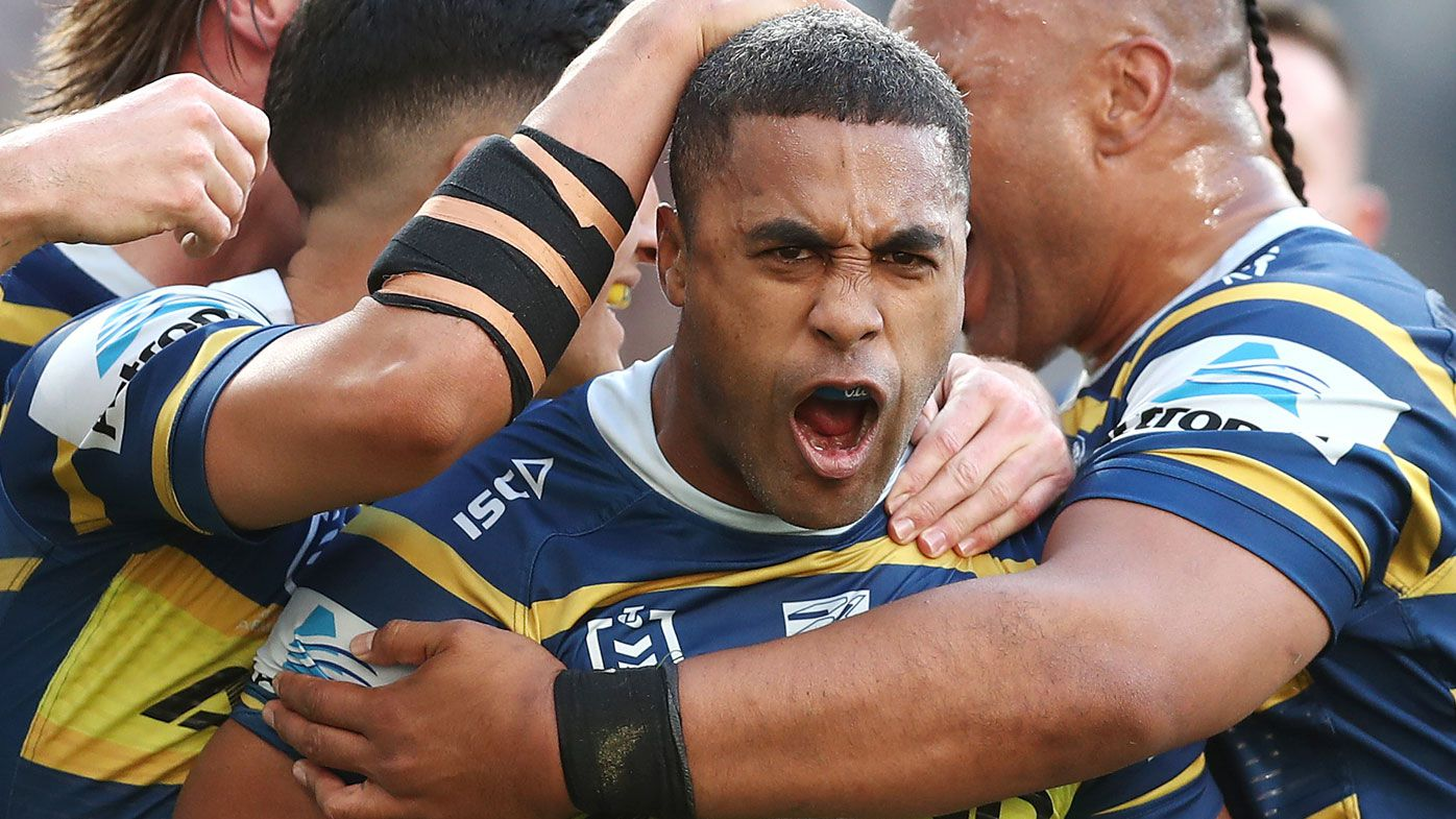 Michael Jennings of the Eels celebrates scoring a try