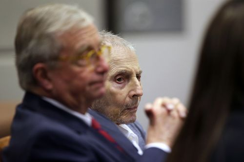 Robert Durst, right, sits with his defense attorney Dick DeGuerin during his murder trial in Los Angeles, Tuesday, March 10, 2020.