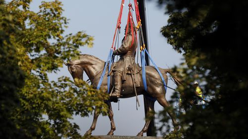 The statue of General Robert E. Lee, which towered over Richmond, Virginia, for generations was taken down.