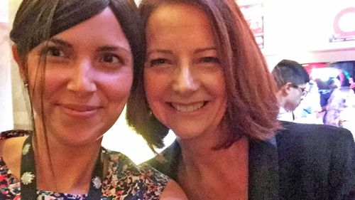 Ms Hodgins with former prime minister Julia Gillard during her time working at the Australian consulate in New York.
