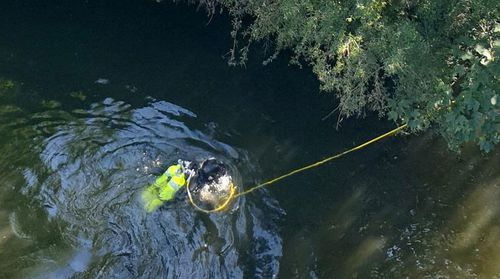 A police diver searches for evidence in the River Spree, close to where Khangoshvili was murdered.