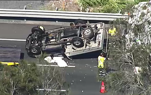 Traffic chaos after ute flips on Brisbane's Gateway Motorway
