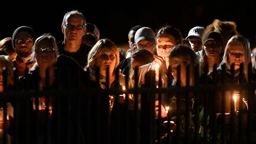 Family members and friends gather for a candlelight vigil memorial at Mohawk Valley Gateway Overlook Pedestrian Bridge.