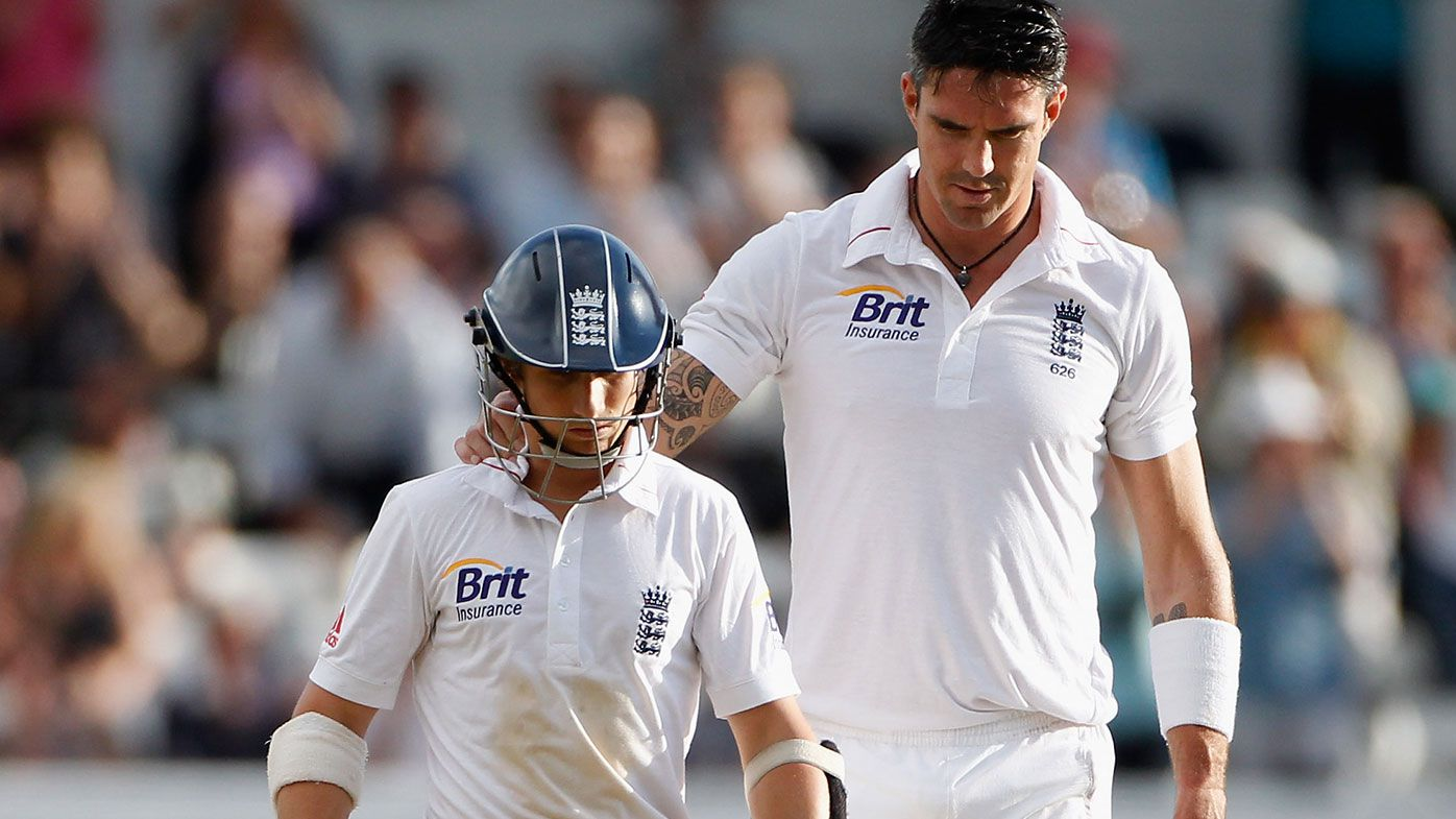 James Taylor of England is consoled by Kevin Pietersen.
